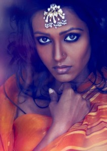 dark-skinned-woman-in-orange-sari